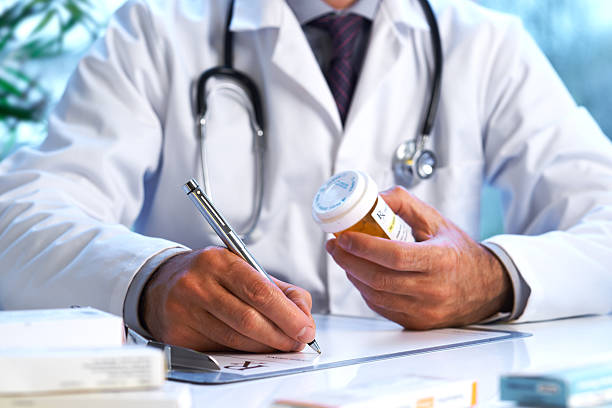 Doctor writing out RX prescription